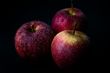 Close up of ripe red apples against black background Stock Photo