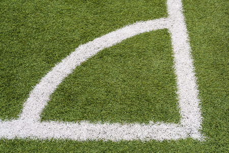 demarcation: Close-up of a football field corner on synthetic surface Stock Photo