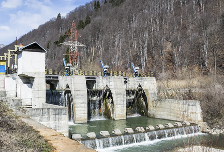harnessing: Small hydro electric dam harnessing water power in a mountain area Stock Photo