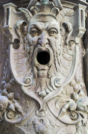 devilish: Architectural detail representing a devilish mythological character Stock Photo