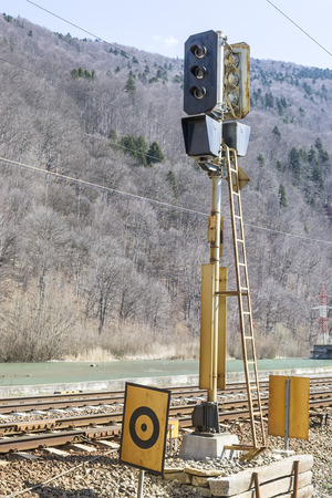 regulating:  Railway traffic light for regulating trains circulation in a mountain area