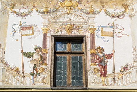 allegoric: Architectural detail of a medieval fresco framing a window