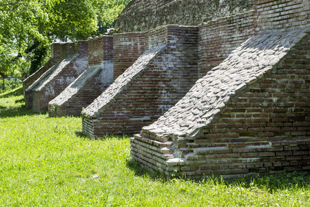 buttresses: Medieval brick buttresses used to increase the strength of a citadel s wall