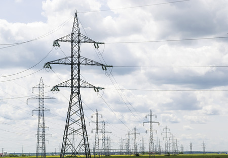 Industrial landscape with large network of electrical power lines for energy distribution