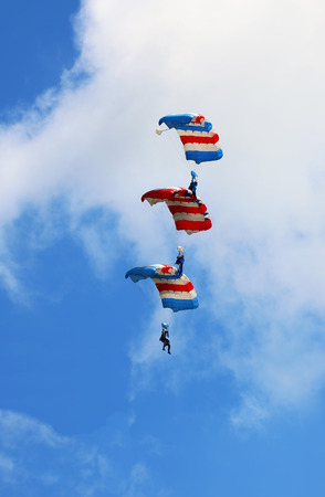 maneuver: Three skydivers descending on top of one another s parachute in canopy aerobatic maneuver