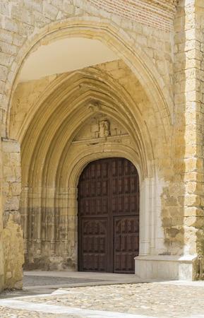edifice: Religious edifice entrance door decorated with multiple stone arcade above it Stock Photo