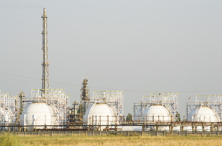 liquefied: Natural gas  stored in high capacity spherical reservoirs at an oil and gas refinery
