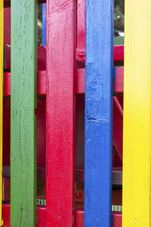 laths: Four vertical wooden laths painted in vibrant colors