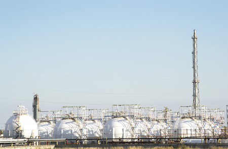liquefied: Spherical reservoirs containing liquefied natural gas on a refinery platform