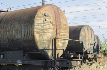 buffers: Rows of freight tank wagons, abandoned on railroad tracks of a former industrial platform