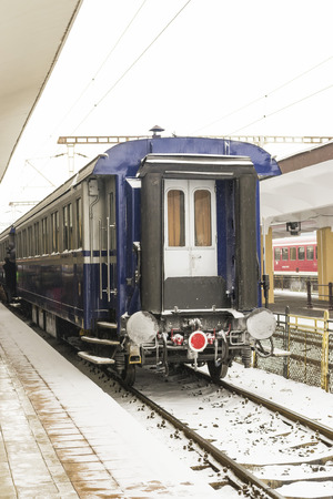 buffers: Rear view of the last passenger car of a train stationed at the railway station Stock Photo