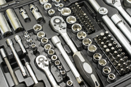Set of tools made of chrome vanadium alloy containing wrenches and different size bits and tubular extensions in a multipurpose kit