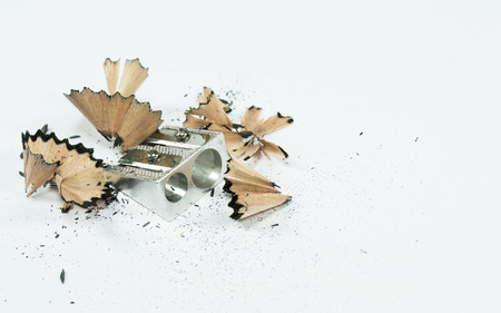 remained: Aluminum double pencil sharpener with scraps remained after a black lead pencil was sharpened