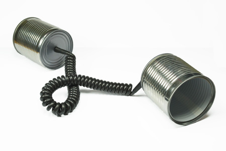 telephone cord: Two aluminum cans connected through a telephone cord  concept for communication Stock Photo
