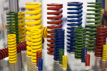 vividly: Bunch of vividly colored metallic coils in different sizes on display Stock Photo