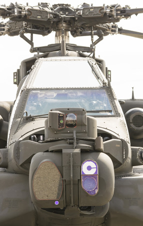 localization: Modern attack helicopter equipped with the latest generation sensors for target localization and surveillance front view of cockpit and main rotor