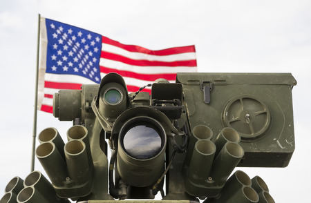 localization: Modern military optical  target acquisition system with United States flag in the background