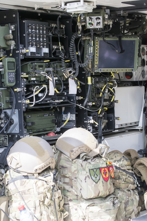 Armored military vehicle interior with multiple electronic equipments for communications and data transmission Foto de archivo