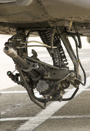 attached: Automatic chain gun attached under the fuselage of a modern attack helicopter
