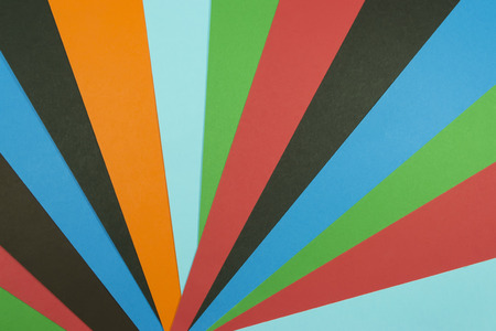 overlapped: Colored paper layers overlapped forming an abstract geometric fan background Stock Photo