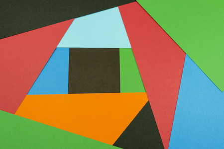 overlapped: Colored paper layers overlapped forming an abstract geometric background Stock Photo
