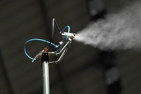 Morning irrigation sprinkler working in botanic garden Stock Photo - 7868469