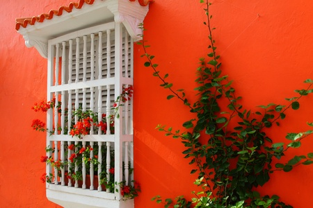 Balcony with flowers. Spanish colonial home. Cartagena de Indias, Colombia.