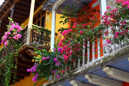 Balcony with flowers. Spanish colonial home. Cartagena de Indias, Colombia. photo