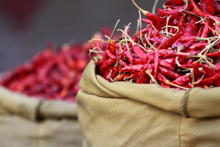 capsaicin: Red paprica in traditional vegetable market in India. Stock Photo