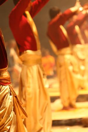 An unidentified Hindu priest during religious Ganga Aarti ritual photo