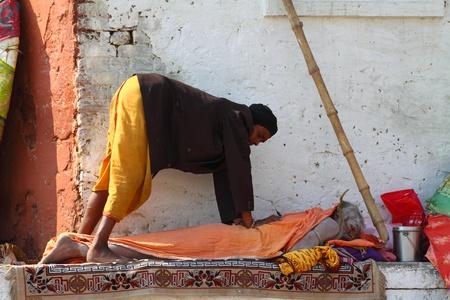 Indian men doing yoga  in Varanasi, Uttar Pradesh, India.