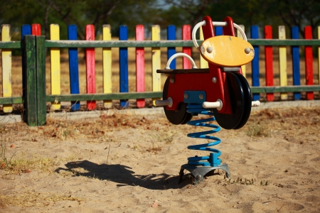 Playgrounds wooden horse and moto photo