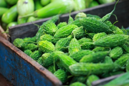 Green paprica in traditional vegetable market in India.  photo