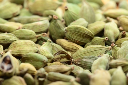 Green cardamom seeds. Aromatic spice.texture background photo
