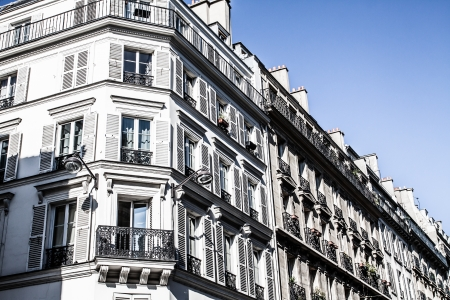 housing style: Facade of a traditional building in downtown Paris, France  ( HDR image )