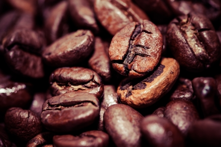 Coffee beans on grunge wooden background  Stock Photo - 17481868