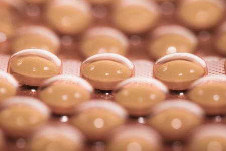 Background from macro of yellow medicine pills  photo
