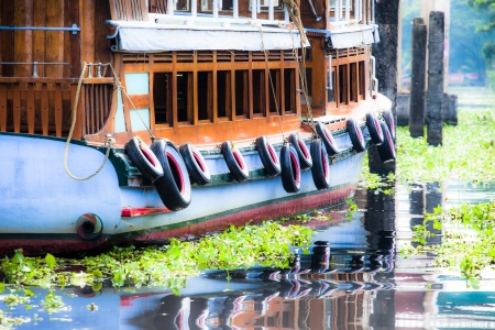 alleppey: House boat in backwaters near palms in Alappuzha, Kerala, India ( HDR image )