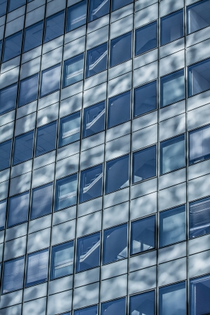 Blue sky reflected in the glass building. Stock Photo - 17652768