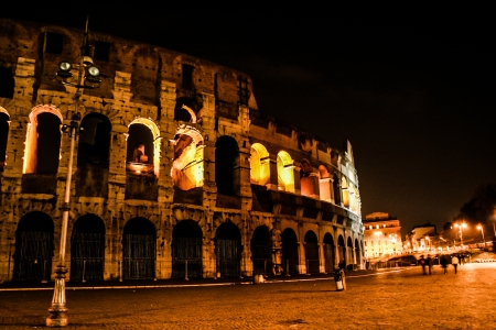 The Colosseum under the glow of lights at night, Rome  photo
