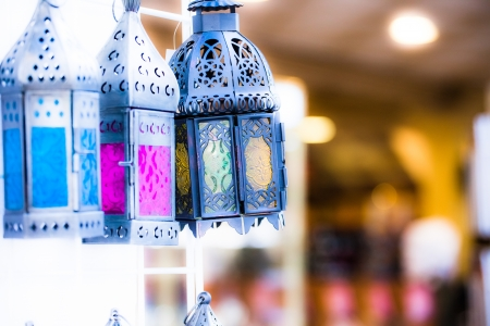 colorful light display: Moroccan glass and metal lanterns lamps in Marrakesh souq Stock Photo