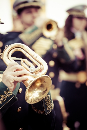 marching: Vintage trombones playing in a big band. Editorial