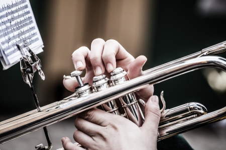 listen music: Vintage trombones playing in a big band. Stock Photo