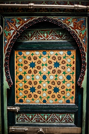 Detail of the beautiful tile mosaic decoration of the at Fez, Morocco. photo