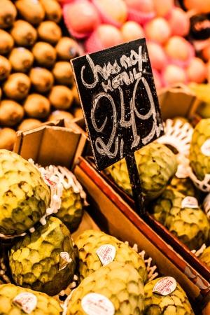 chirimoya: Fresh green Cherimoyas in Central Market, Barcelona, Spain. Stock Photo