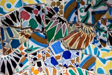 guell: BARCELONA,SPAIN-APRIL 13: Detail of the bench in the park Guell, designed by Antonio Gaudi, on April, 13 2013 in Barcelona. Part of the UNESCO World Heritage Site Works Stock Photo