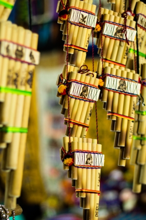 Authentic south american panflutes  in local market in Peru. photo