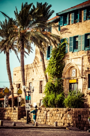 holyland: House with palms in Jaffa, a southern oldest part of Tel Aviv - Jaffa municipality, an ancient port city. Jaffa is famous for its association with the biblical story of the prophet Jonah