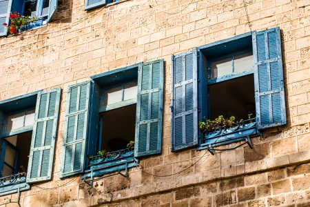 jewish home: Windows in old building in Israel Stock Photo
