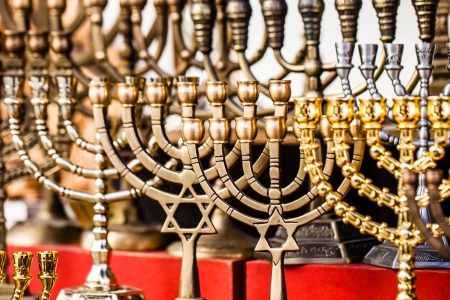 hanukiah: Menorah for sale in shop in the Jerusalem old city market. Hanukkah Jewish holiday is observed for eight nights and days.